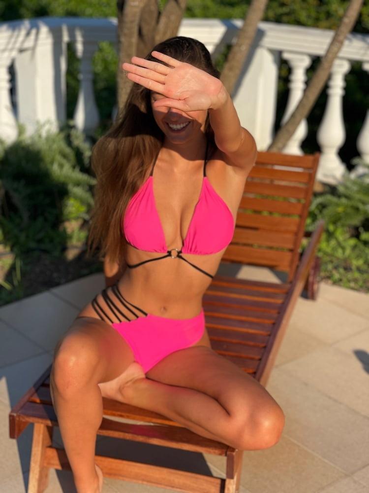 Hot Brunette with Big Natural Tits in Pink Bikini